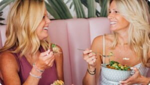 Two women laughing at lunch