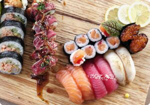Colorful sushis on a wooden board